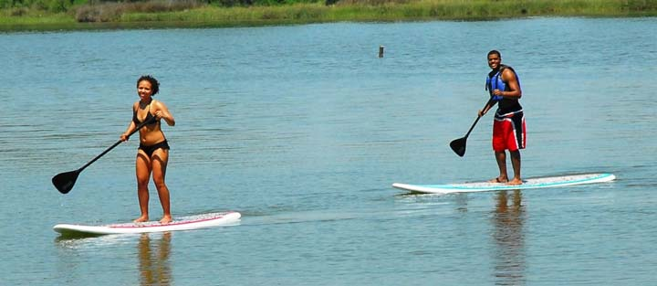 stand up paddleboarding couple
