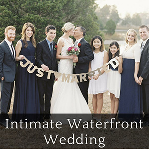 Wedding party surrounding bride and groom