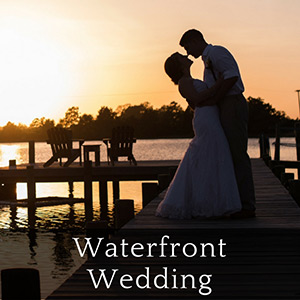 Wedding couple in silhouette at sunset