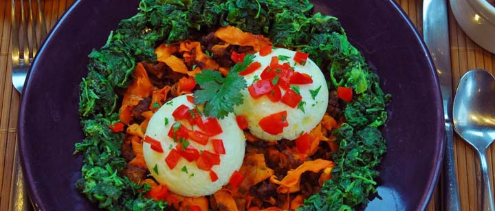 Poached eggs sweet potato and chorizo hash and creamed spinach