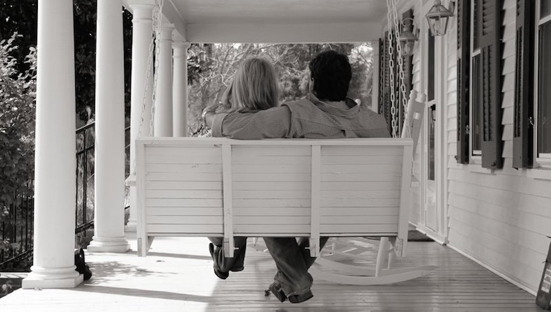 Couple on porch swing