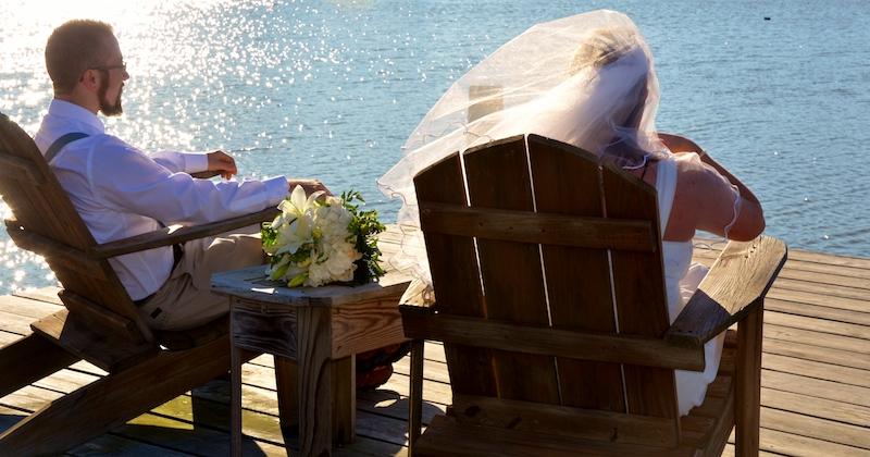 Wedding couple on elopement sitting on dock