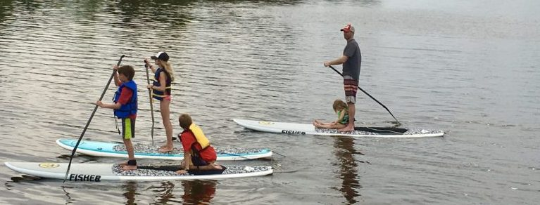 Family paddleboarding together