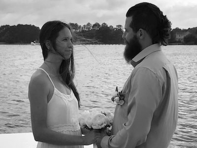 wedding couple holding hands at elopement