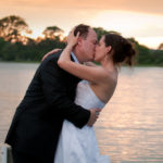 Elopement couple kissing on waterfront