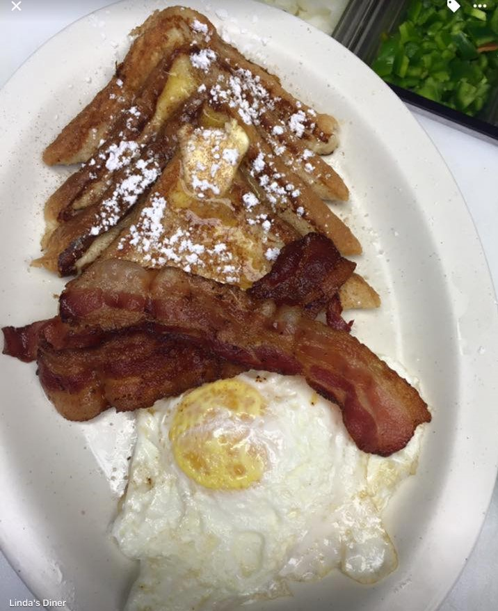 photo of fresh toast slices, bacon and fried eggs
