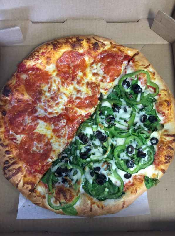 photo of a pizza, one half is cheese and pepperoni and the other half is green peppers and olives with cheese