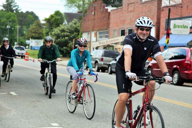 group of bicyclist riding into town