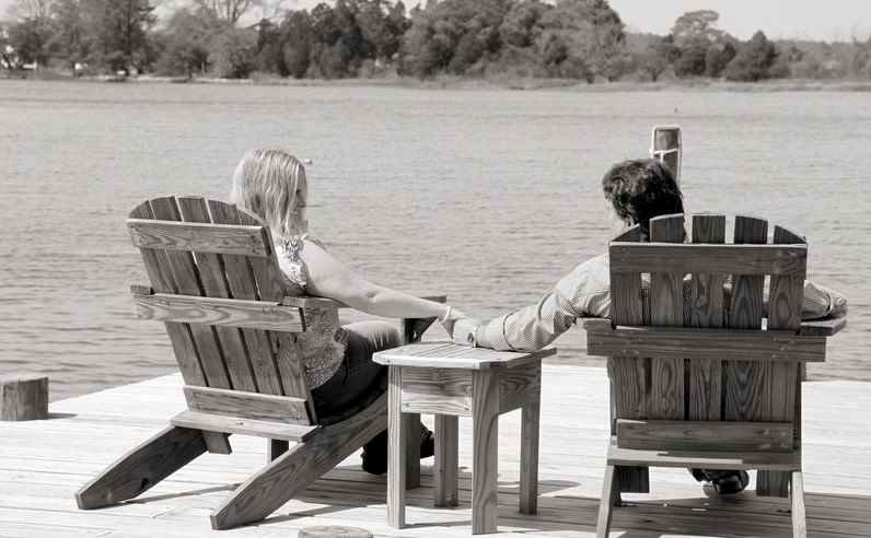 couple holding hands on dock