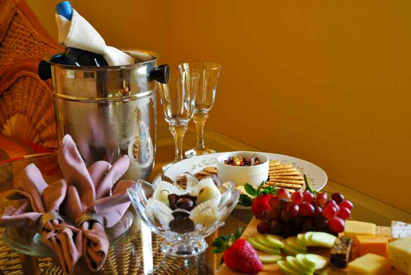 champagne on ice, chocolate truffles, 2 champagne flutes, crackers and a fruit and cheese board